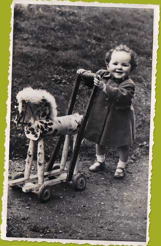 Old photo child with early baby walker